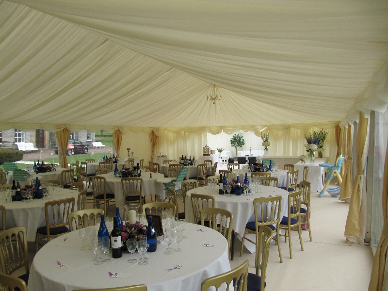 simple blue and gold wedding marquee interior